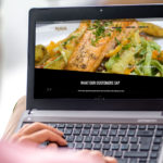 NyKo's Restaurant website displayed on a laptop